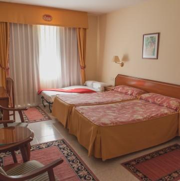 Doble con Sofá Hotel